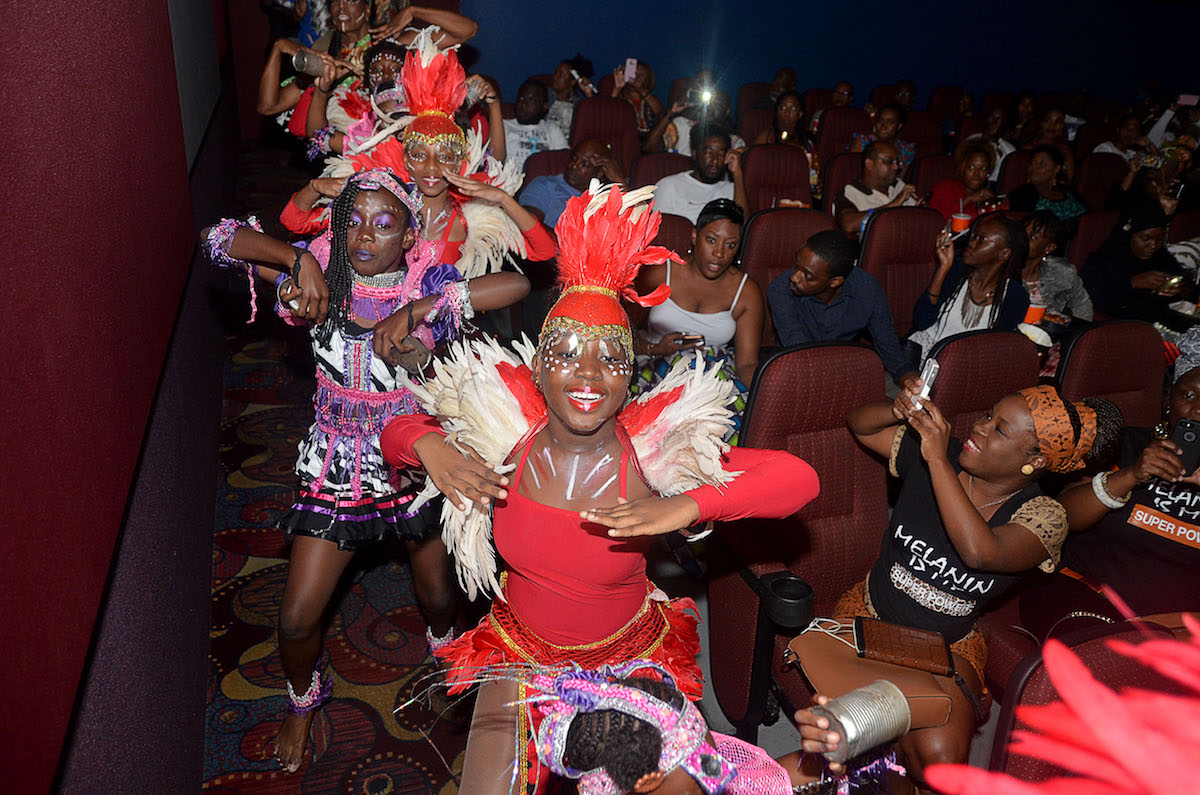 Zante Dancers dance down the aisle of the movie theatre before the 7:30pm screening of Black Panther